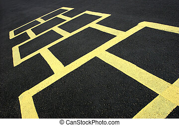 hopscotch game yellow on pavement - hopscotch jumping game...