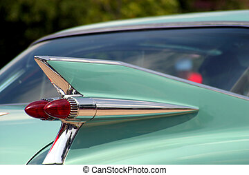 Retro Tail Fin - The tail fin of a vintage car.