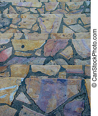 Flagstone Path - A pathway of multicolored flagstone in...
