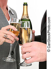 Champagne For Two - Close-up Business Couple Pouring...