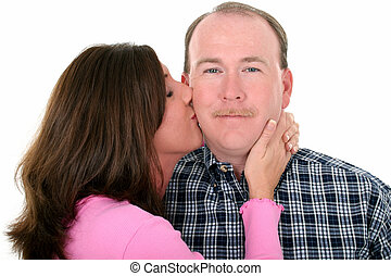 Couple Kissing - Woman kissing man on cheek. Shot in studio...