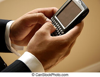 Text Messaging - Mobile Businessman Sending A Text Message
