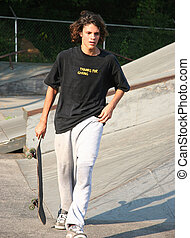 Handsome Sweaty Skateboarder - Full body shot of handsome...