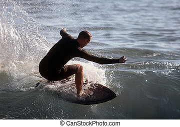 Surfer - Young man surfing