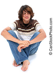 Teen Boy Sitting On White Floor - Teen boy in casual clothes...