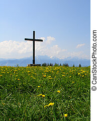 On top of the world - Wooden cross on top of mountain