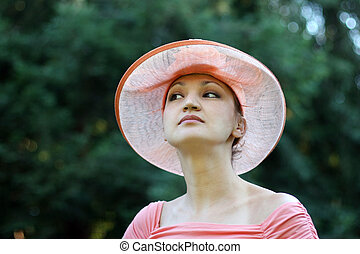 Elegance - Woman in a pink straw hat