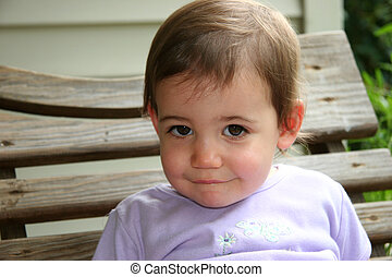 Adorable Baby Girl - Close-up of an adorable baby girl on a...