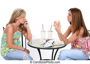Woman Lunch Food - Two beautiful young women having lunch...