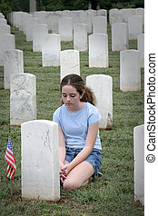 Casualties of War 2 - a young girl mourning a fallen soldier...