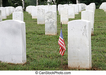 Soldiers Grave - a soldiers grave with an american flag, in...