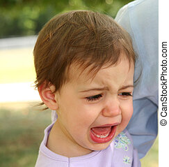 Baby Girl Crying - Close-up of baby girl crying while her...