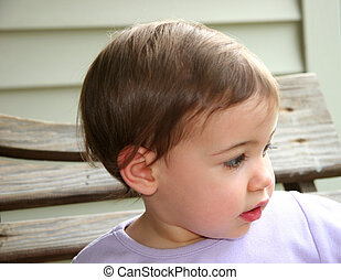 Baby Girl Profile - Profile of an adorable baby girl on a...