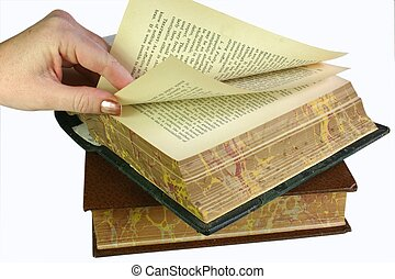 Browsing the pages - Hand turning and browsing pages in old...