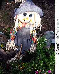Scary Girl - Little girl scarecrow on picket fence