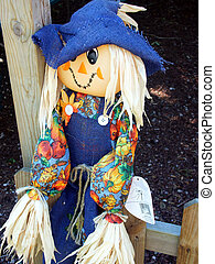 Taking a Break - Little girl scarecrow sitting on fence