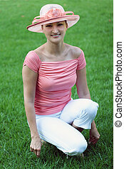 Girl in a pink hat - Woman in a pink straw hat