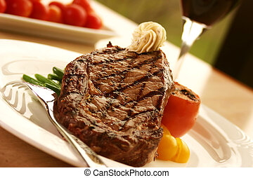 Rib Eye Steak - 12oz ribeye steak topped with truffle butter...