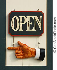 We're Open - Open sign with pointing hand