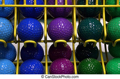 Mini-golf Balls - Miniature golf balls on a rack