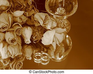 Memories - Close-up of a glass of brandy, dry roses bouquet,...