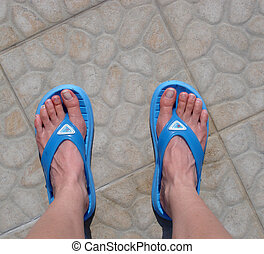 Feet in flipflops - Blue flip-flops worn on feet
