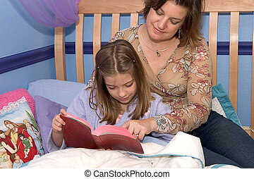 Bedtime Bible Study1 - A mother and daughter reading the...