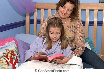 Bedtime Bible Study2 - A mother and daughter reading the...