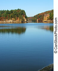 Fall Reflections - Fall reflections on a river in the...