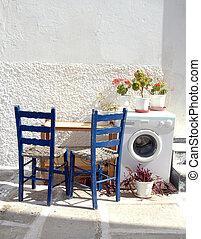 greek islands street scene - a street scene in the greek...