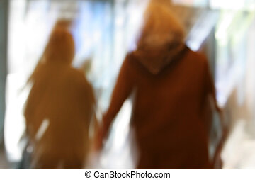 Muslim mother blur - Artistic blur of Muslim mother and...