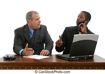 Business Meeting On Hold - Two businessmen at desk...