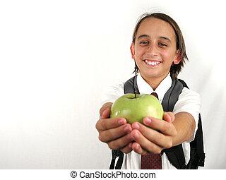 Apple For Teacher - a school boy holding out an apple for...
