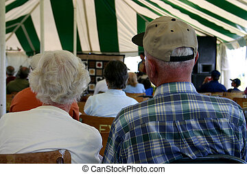 senior audience - a senior couple in the audience of a local...