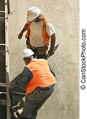 Men at work - Two men laying formwork