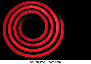 Hot - A red hot burner isolated on a black background