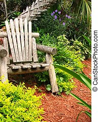 Wood Chair - A shot of a wood chair surrounded by folige and...
