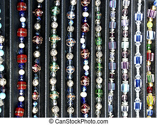 Strung Beads - Strings of beads, necklaces and bracelets