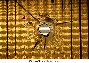 Bullet hole - Yellow glass with gun shot hole.