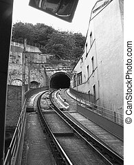 One way track - one way train going through the mountain in...