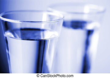 Blue Water - Two glasses of drinking water close up with...