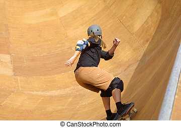 skateboarder going - skateboarder riding the bowl