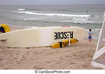 Rescue 1 - Surf Board used to rescue people from rip tides,...