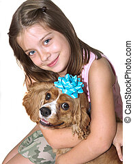Happy Together Isolated - a little girl hugging her spaniel...