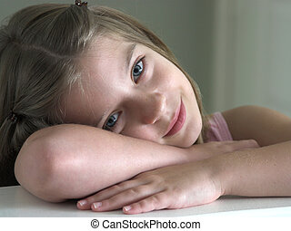 Precious Angel - a little girl resting her head on her arms...