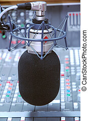 studio microphone and editing suite - modern studio...