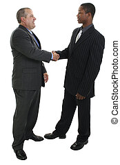 Men Shaking Hands - Two men in suits shaking hands Shot in...