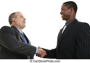 Businessmen Handshake - Two businessmen smiling and shaking...