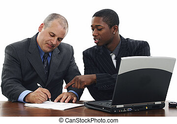 Signing Contracts - Two men in suits at desk signing papers...