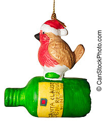 robin on a bottle christmas decoration against a light...